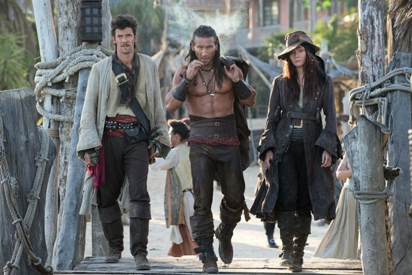 *************** TV PREVIEW FOR JANUARY 5, 2014. DO NOT USE PRIOR TO PUBLICATION.**************From left, Toby Schmitz (Jack Rackham) Zach McGowan (Charles Vane) Clara Paget (Anne Bonny star in Starz Entertainment's series BLACK SAILS. Photo Credit: Starz Entertainment.